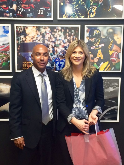 Queens student Alyssa Spagnolo with CFL Commissioner Jeffrey Orridge during CEOx1Day