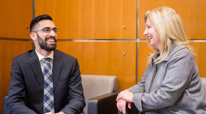 Vancity CEO Tamara Vrooman is with Simon Fraser University student Beedie Gurjodh Mahal